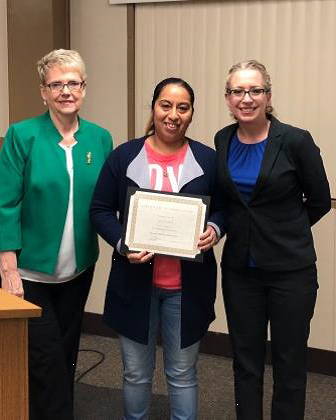 Ana Palmas was recognized by Sheila Collins and Yvette Fagundes- Hall for her volunteerism at Waterford Junior High School.