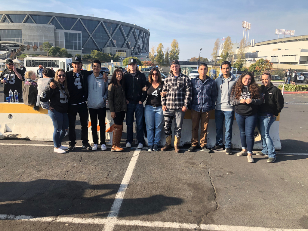 Principal Herndon, Coach Krissy, and our WHS students at the Raiders game