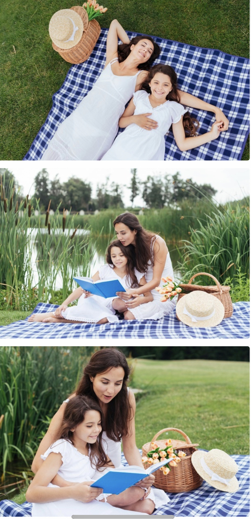 Family reading together and having a picnic