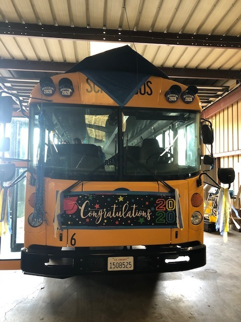 Even the bus has a graduation cap!